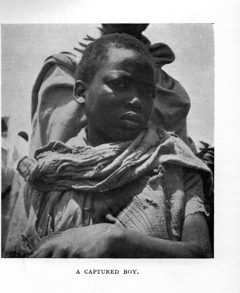 Ethiopian slave boy:  Governors and soldiers from the Amhara kings of Ethiopia captured and sold slaves from among the darker tribal peoples of SW Ethiopia.