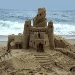 I've never mad such a fancy sand castle.  But look how fragile it looks with the ocean coming in behind!